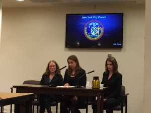 NYATN member Sex Workers Project's Crystal DeBoise (center) testifies alongside Legal Aid's Hollis Pfitsch and Catholic Migration Services's Alice Davis